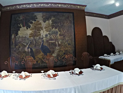 Tapestry & head table in wedding reception room