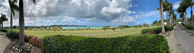 Panorama of the ocean, fields, and the Tourism Minister's estate