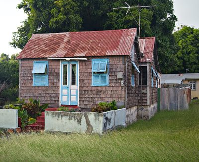 Little shake house with a red tin roof