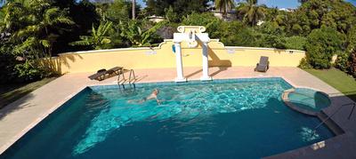 Joe having an early morning swim in the pool