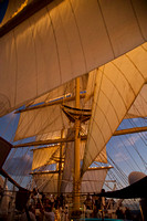 Sunset lighting the Royal Clipper's sails as she leaves the harb