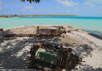 Rusting mechanical debris beside the lagoon