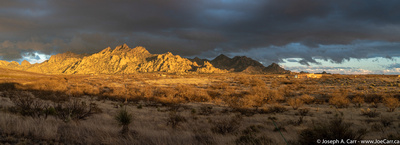 Sunset lighting the Dragoon Mountains with storm clouds
