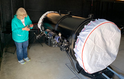 Diane installing shrouds on Garry's telescopes