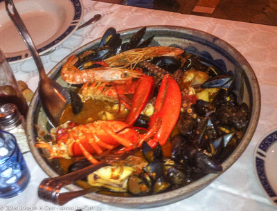Seafood stew cooked in an amphora