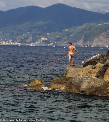 Fishing on the rock seawall at Riomaggiore