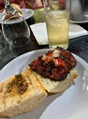 Chimichurri - beef sausage on a bun with two sauces