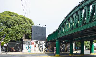Urban art on walls of abandonded overhead urban rail near Plaza Jardines de Invienrno