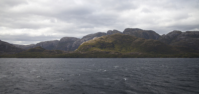 Hills, mountains and shoreline as we sail through the channel