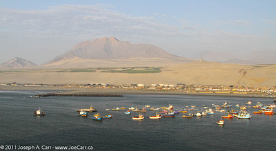 Fish boats with mountain & desert behind