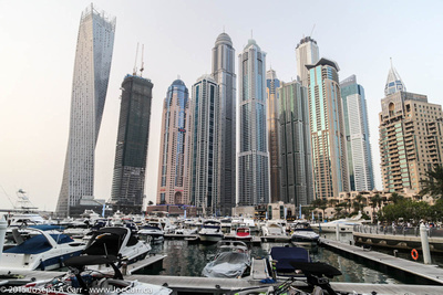 Cayan Tower beside other skyscrapers & moored boats