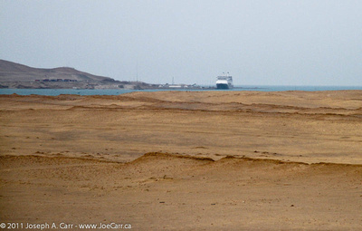 Rotterdam in the distance across the Paracas Bay sand dunes