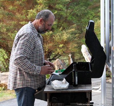 Graeme cooking the fish on the BBQ