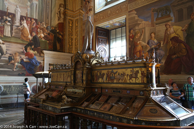 Frescos and ornate ancient bookcase