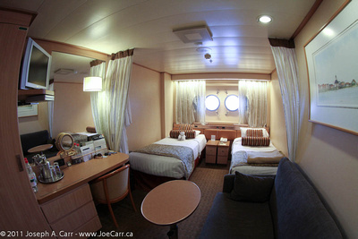 Sofa, desk, beds & portholes in my cabin