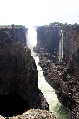 Zimbabwe side of Victoria Falls in the distance, with the dry Zambian side in the foreground