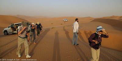 Group and guide on the dunes