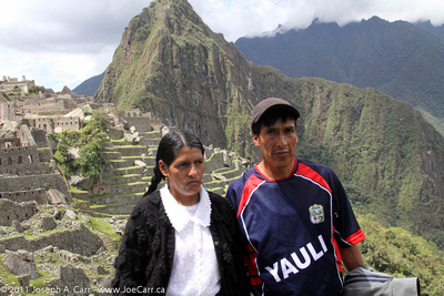 Mourning Peruvian couple visiting the site