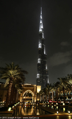 Burj Khalifa tower & the Palace Hotel pools courtyard lit up at night