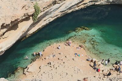 Swimmers in the Bimmah Sinkhole