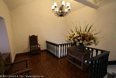 Landing with furniture and live flower arrangement