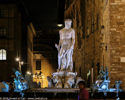 Poseiden statue at night