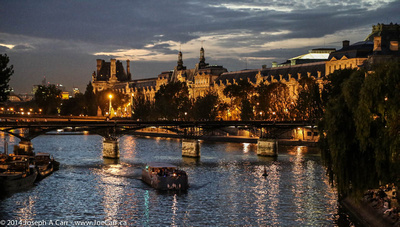 Cruise boats on the Seine at night