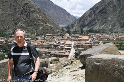Joe on the top of the fortress with Ollantaytambo and the Sacred Valley below