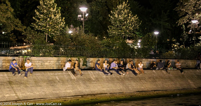 People enjoying themselves on the Seine at night