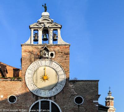 San Giacomo di Rialto and its large 15th century clock above the entrance