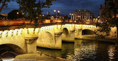 Pont Neuf and La Samaritaine store lit at night