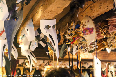 Masks hanging from a shop ceiling