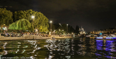 A party on the shores of the Seine at night