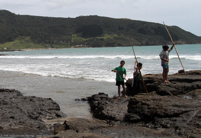 Kids playing on the rocks at Ninety Mile Beach