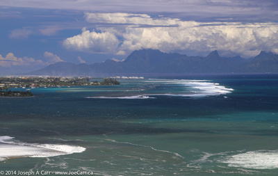 Papeete and the reef from the North Shore with Moorea behind