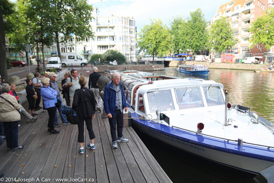 Our group waits to regroup after the canal tour boat