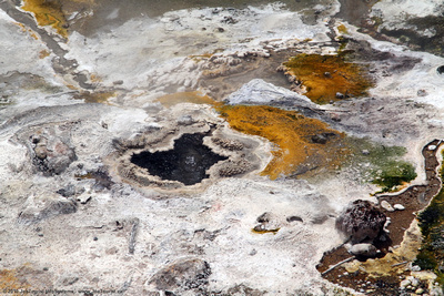 Mineral deposits & small geyser in the hot stream