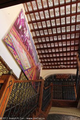 Tile ceiling and mural with staircase