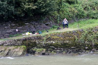Fisherman on the banks of the Rhine River