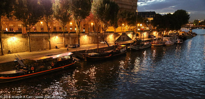 Cruise boats near Pont Neuf at night