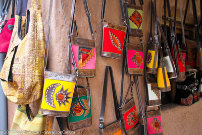 Handmade leather bags with fabric designs