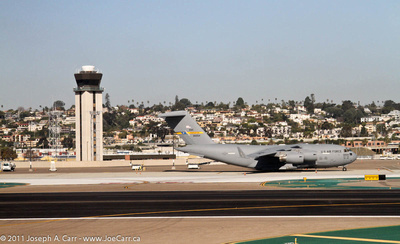 San Diego airport tower and US military aircraft on runway