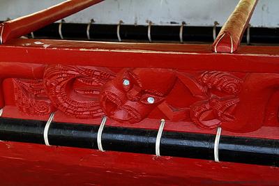 Carved figures on side of giant canoe Ngatokimatawhaorua
