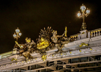 Statutory decorations on Pont de Concorde at night