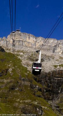 Looking up toward Birg gondola station with a gondola approaching us