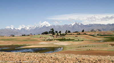 Andes mountains behind a valley used for agriculture