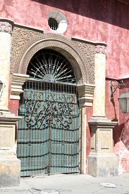 Ornate iron gate & archway