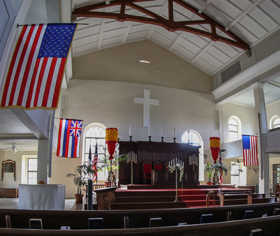 Alter and flags inside the church sanctuary