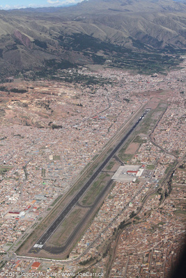 Cusco Airport runway surrounded by the city of Cusco