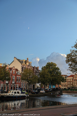 Five day old crescent Moon over the main river running through Haarlem